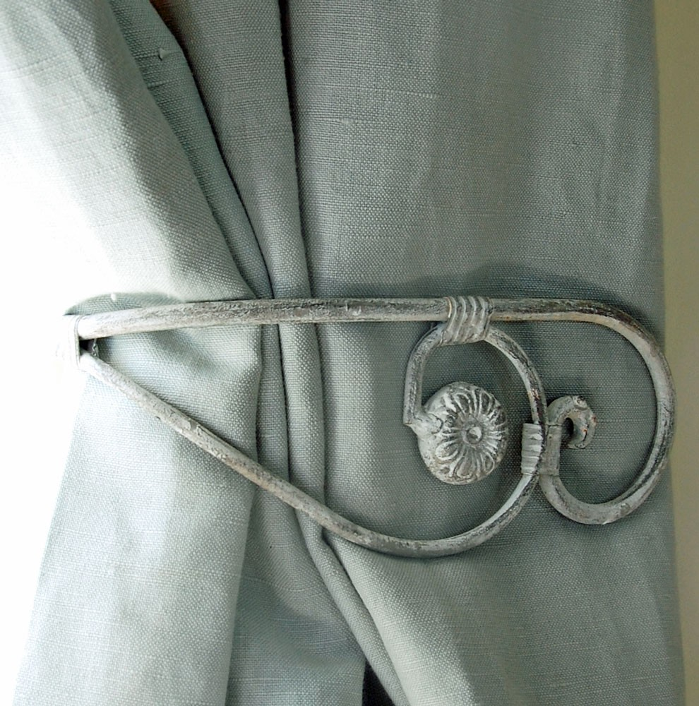 Wise use of decorative metal curtain tie   backs