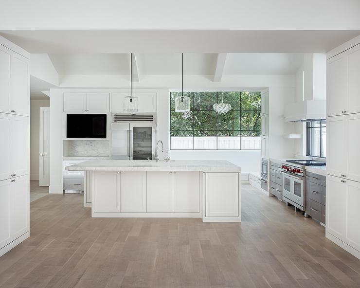 White Modern Kitchen with Gray Wash Wood Floors - Modern - Kitchen