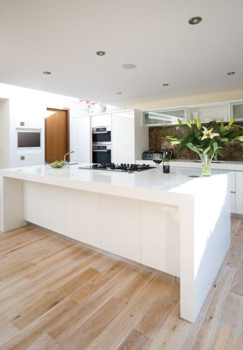 Plank white oak wood floor with a white-washed finishing technique