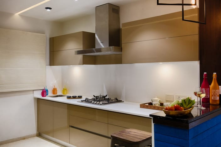 Beige Cabinets And Modern Interior of Parallel Kitchen with White Counter  Top