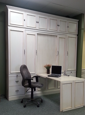 Murphy bed shown with the desk folded out.