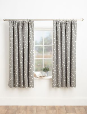 Stylish pencil pleat curtains with a star design in a satin and matt