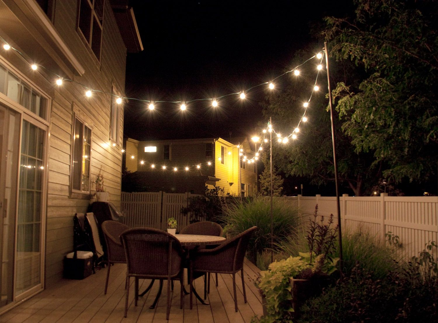 How to make inexpensive poles to hang string lights on - café style! Via  Bright July
