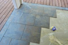 Young House Love--tile back patio over concrete