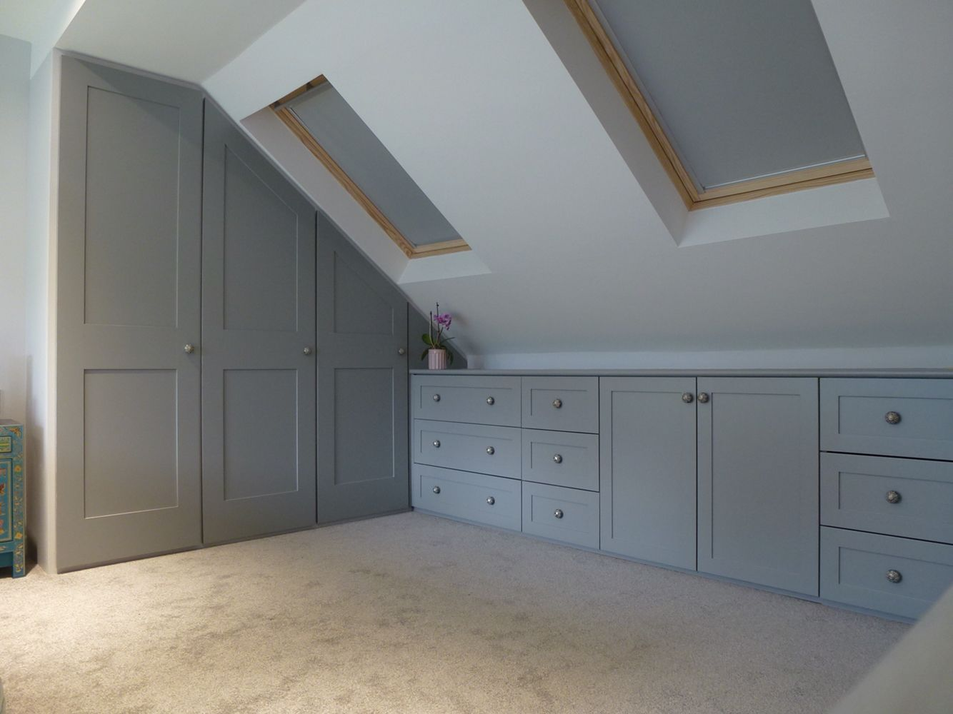 Fitted wardrobes built into loft conversion. Storage drawer units shaker  style doors and drawers. Pull out hanging rails.