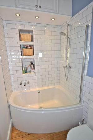 simple corner tub/shower combo in small bathroom | bathroom