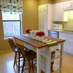 Manage the space with small kitchen   island with seating and storage