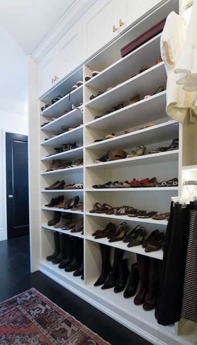Full view of closet hutch custom walk-in closet shoe shelves