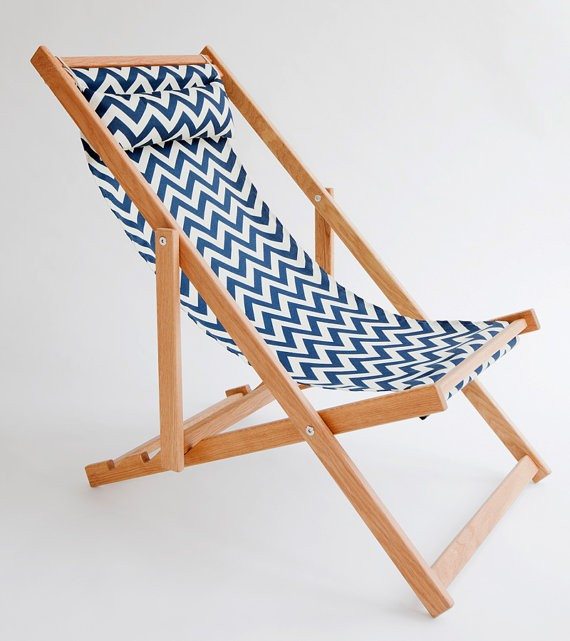 Above: A handmade Huron Deck Chair with a chevron pattern polyester sling  and frame made of North American white oak packs flat; made in Vancouver,