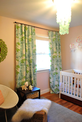 Chic baby girlu0027s pink nursery with colorful blue and green floral curtains  featuring nursery blackout curtains