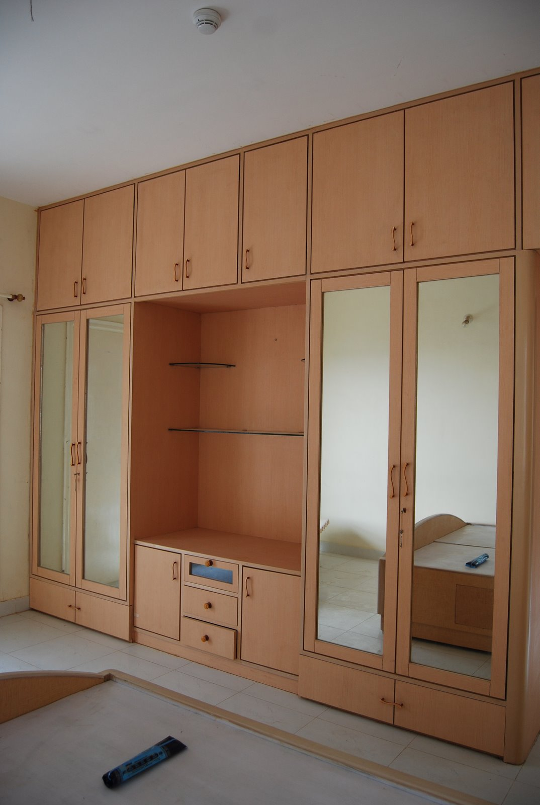 Chic Bedroom Attractive Minimalist Solid Black Enclosed Wardrobe Closet Design  With White Floor woodwork designs for bedroom cupboards