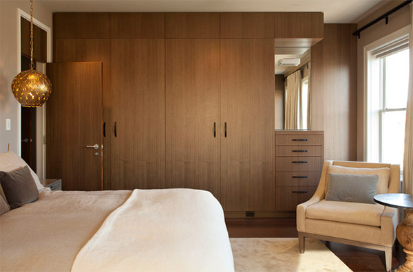 Elegant A lovely contemporary bedroom that sure has enough storage with this wooden wall wardrobe design for bedroom
