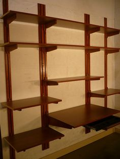 Elegant Adjustable, wall-mounted shelving that is all wood wall mounted adjustable shelving