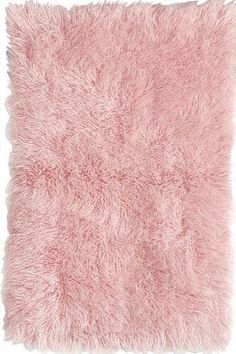Elegant Created using a centuries-old process, New Zealand wool is hand crafted to pink fluffy rug
