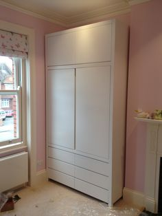 Elegant Free standing wardrobe, features include soft close draws and integrated  pull handles bespoke free standing wardrobes