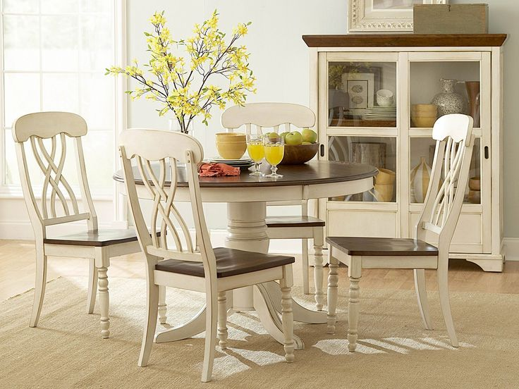 Elegant round kitchen table and chairs and a glass cabinet round kitchen table and chairs