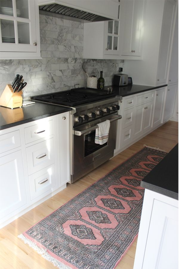 Elegant Rug in the kitchen. Nice marble backsplash with black counters (which is kitchen runner rugs