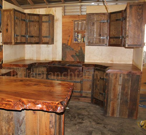 Elegant rustic kitchen cabinets   Rustic cabinets with hand forged hinges and rustic wood kitchen cabinets