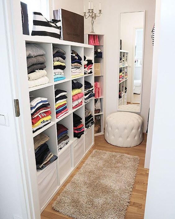 Modern This closet Via House of Philia has the same type of Pax small walk in closet ideas