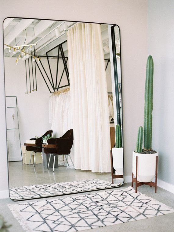 New oversized wall mirror, cute cactus and a Moroccan rug bedroom wall mirrors