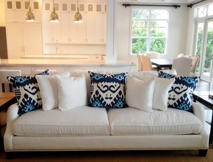 New White sofa with white and blue throw pillows. white sofa pillows
