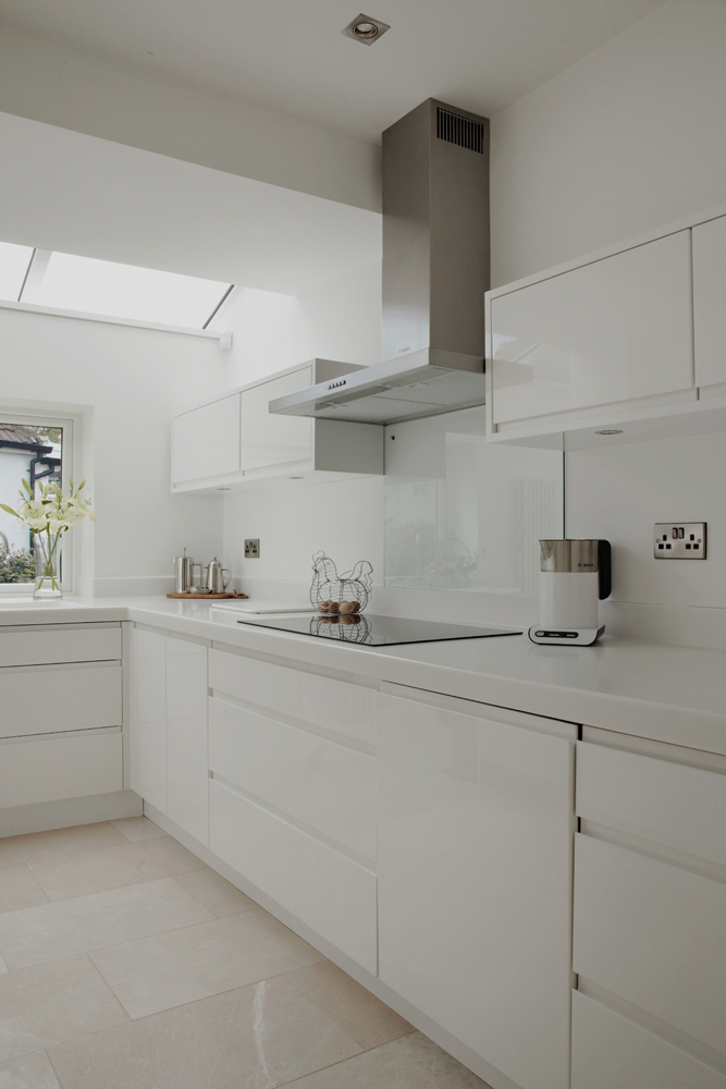 Photos of Minimal white gloss kitchen with solid surface worktops p white kitchen work tops