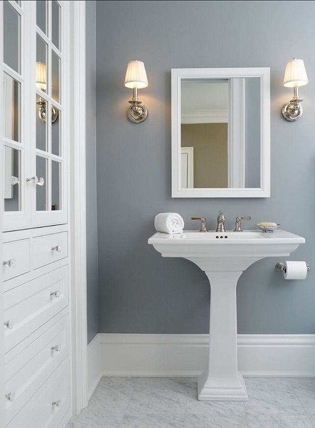 Popular Solitude by Benjamin Moore looks amazing in this bathroom designed by best gray paint colors for bathroom