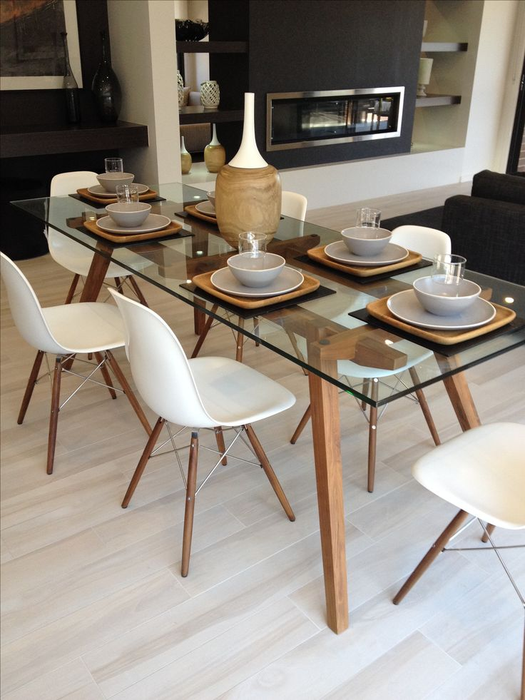 Popular Sticotti glass dining table and Eames dining chairs in walnut glass dining room sets