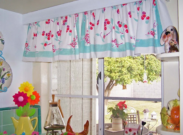 Beautiful Vintage tablecloth into kitchen curtains. Aqua and Cherries....so fresh. retro kitchen curtains