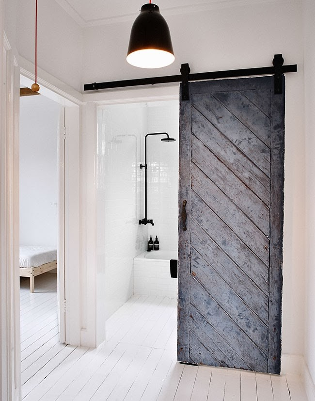 Best ... Reused old barn door creates a fabulous entrance for the Scandinavian sliding doors for bathroom entrance