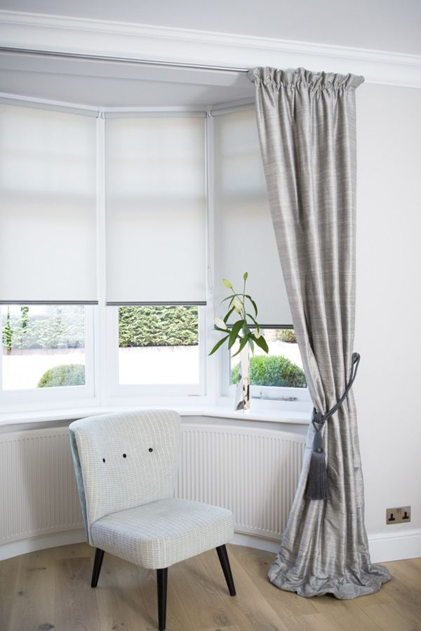 Images of Dressing a bay window by combining curtains and roller blinds creating a square bay window curtains