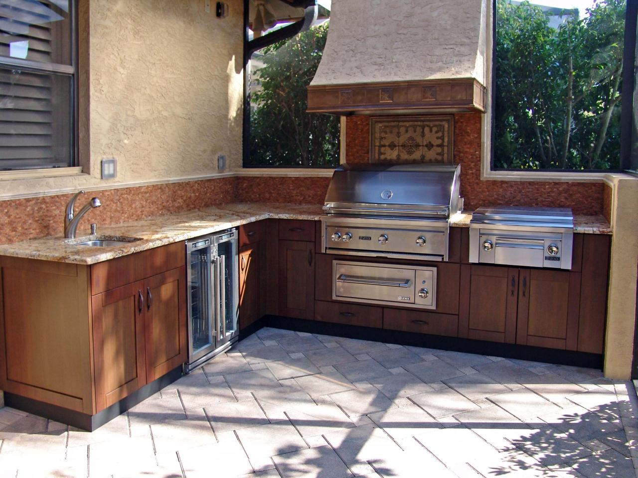 Stunning Outdoor Kitchen Cabinet Ideas: Pictures, Tips u0026 Expert Advice | HGTV outdoor kitchen cabinets
