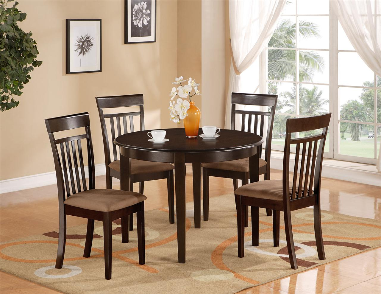 Stylish round kitchen table and chairs with brick wall and flower vase on round kitchen table and chairs