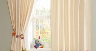 Stylish Timbuktales - Tab Top Curtains...THIS SWEET IVORY CURTAIN W/COLORFUL PRINTED tab top curtains with buttons