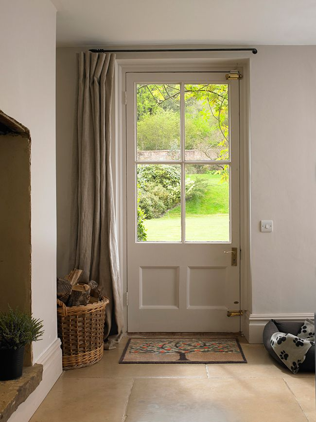 Cute Warm up your entrance hall with fabric draped across the door. Pale thermal front door curtain