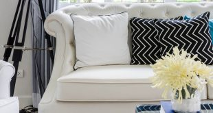 Chic White sofa with a white pillow and black pillow with white crooked white sofa pillows