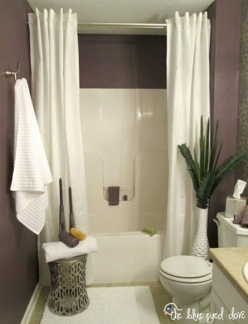bathroom shower curtains hang a second shower curtain to make your tub seem extra AHSJXHU