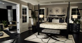 black furniture rich bedroom with dark flooring and furniture. DADWZNB