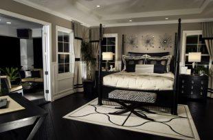 black furniture rich bedroom with dark flooring and furniture. DADWZNB