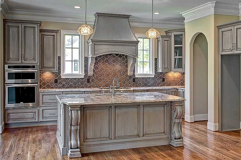custom kitchen cabinets an elegant back splash brings high-end detail to this custom kitchen NRUZXKB