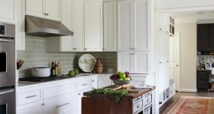 custom kitchen cabinets white transitional kitchen with gray subway tile backsplash IUHHTVC