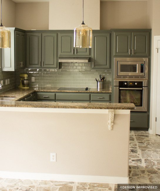 green painted kitchen cabinets with teal backsplash PMIIAJF