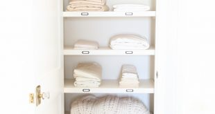 linen closets organize a hall closet with these easy tips from home blogger OTNBYPQ