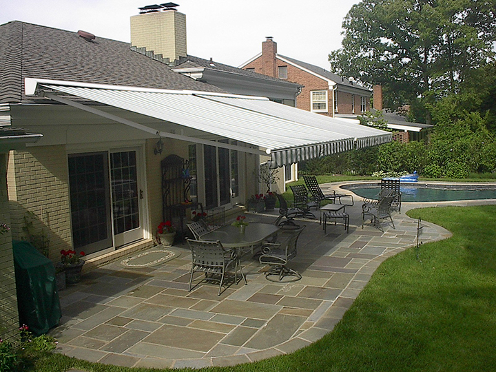 patio awning two retractable awnings side by side over a stone patio with OCXUUNR