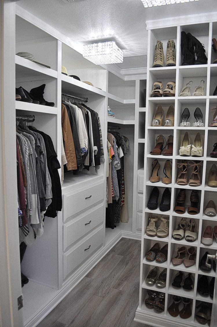 walk in wardrobes designs very well organized walk-in closet with white cabinets and storage units LJJSYAE