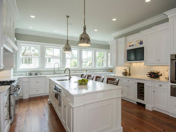white kitchen cabinets white cottage kitchen with metal pendants LPGPNMK