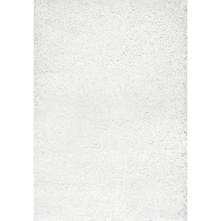 white rug welford white shag area rug SKBTRBK