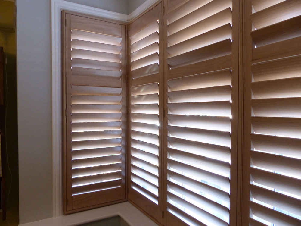 wooden shutters square bay window with natural wood shutters fitted UMQXLEJ