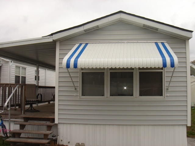 Window Awnings in Largo FL | Fold-Down Aluminum Clamshell - West