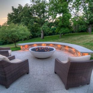 Large transitional backyard stamped concrete patio photo in Cedar Rapids  with a fire pit and a